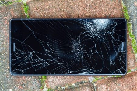 cell phone dropped on the ground with broken screen