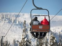 skiiers on a chair lift