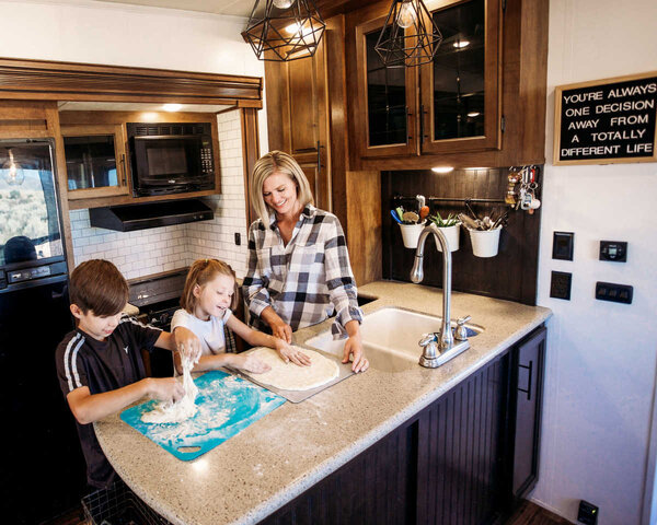 mom & kids cooking in an rv kitchen