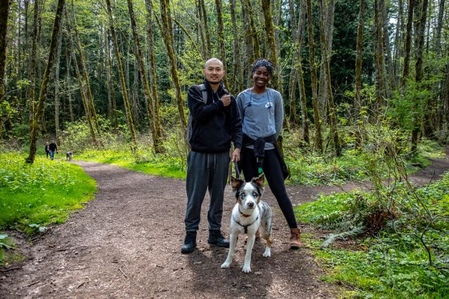A couple and their dog on a Cougar Mountain trail walk
