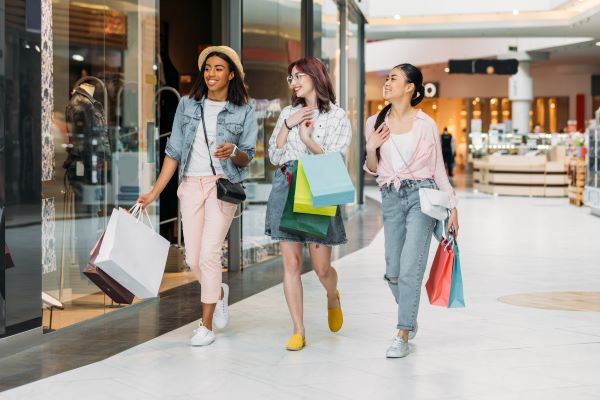 young women shopping at an indoor shopping mall