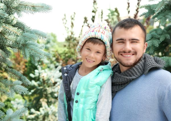 father and son at a christmas tree farm