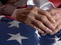 Veteran holding American flag