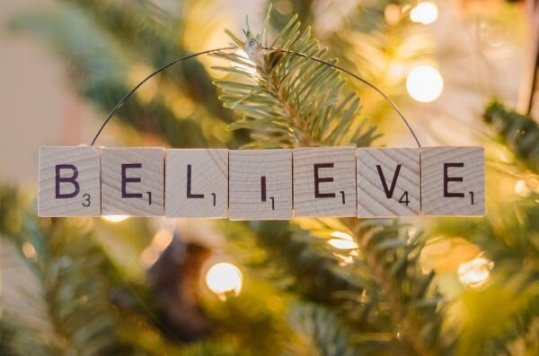 "Lighted tree with ""believe"" in scrabble tiles"