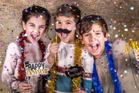 kids celebrating new years eve at home