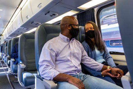 Couple traveling on Amtrak train