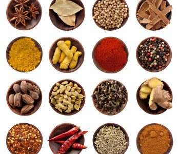 Collection of spices in small wooden bowls