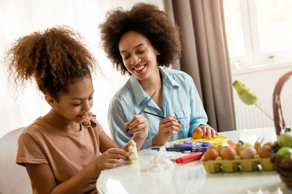 mother and daughter coloring easter eggs