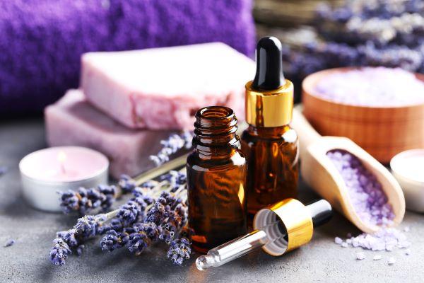 lavender products: candle, soap, bath salts, essential oil