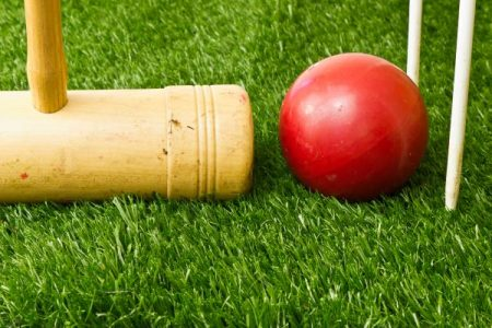 croquet mallet, ball, and wick