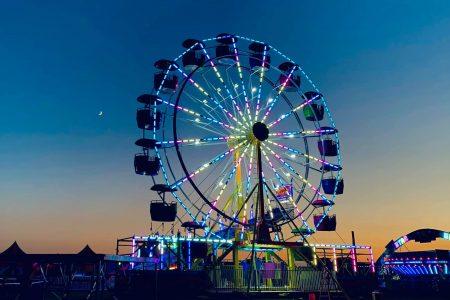 Ferris wheel at night. Carnival at Harvey Field 2021