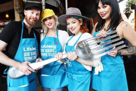 Lifelong Dining Out For Life (workers holding giant fork)